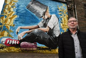 Dundee Drugs Commission chairman Robert Peat stands beside a mural of Oor Wullie with his bucket over his head, painted to raise awareness of mental health and addiction issues (Picture: John Devlin)