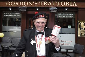 Charity collector Tom Gilzean pictured on his 95th birthday outside Gordon's Trattoria where they put on a special birthday lunch for him. (Picture: Greg Macvean)