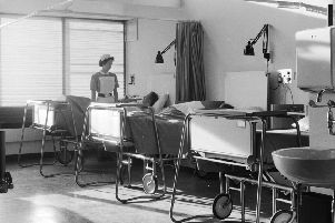 A haven of tranquility: a hospital ward, caring nurses and a tea trolley (Picture: Chris Ware/Keystone Features/Getty Images)