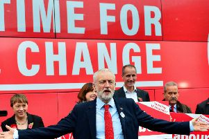 This is either Kevan Christie in a Jeremy Corbyn mask, or the Labour leader himself. We can't tell. (Picture: Richard Martin-Roberts/Getty Images)