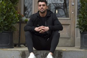 Adam Hastings, sitting outside the Murrayfield Hotel in Edinburgh, is gearing up for a big year with Glasgow Warriors. Picture: Lisa Ferguson