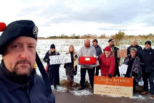 Paul Jamieson and fellow members of the Group to Stop Development at Culloden gather this morning to protest against the latest development bid for the wider battlefield area. PIC: Contributed.