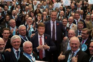 Brexit Party candidates pose with leader Nigel Farage and Brexit Party chairman Richard Tice. (Photo by Dan Kitwood/Getty Images)