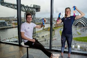 Scott McLay  and Hannah Miley reveal the official medals for Glasgow 2019, the LEN European Short Course Swimming Championships. Picture: SNS.