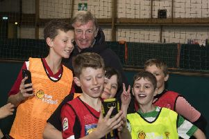 Youngsters take pictures with Kenny Dalglish when the McDonald's Fun Football ambassador paid a surprise visit to a coaching session at  Allander Leisure Centre in Bearsden.