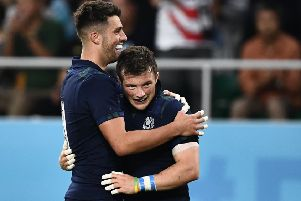 George Horne, right, celebrates his World Cup try against Russia with Adam Hastings. The pair have made a big impact on their return. Picture: AFP/Getty
