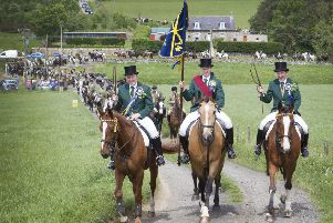 The 2019 common riding cavalcade leaves the hut.