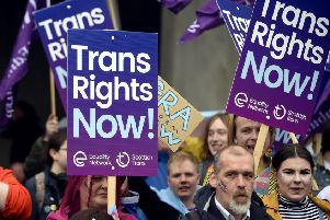 Campaigners for trans rights, which has grown as a political issue in recent years, protest outside the Scottish Parliament (Picture: Lisa Ferguson)