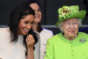 Queen Elizabeth II sits and laughs with Meghan, Duchess of Sussex during a ceremony to open the new Mersey Gateway Bridge. Picture: Jeff J Mitchell/Getty Images