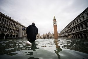 High tide in Venice peaked at five feet above sea level which prompted the mayor to close St Mark's Square. Picture: Getty