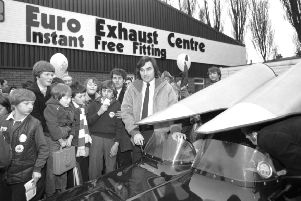Fans greet George Best as he arrives to open the Euro Exhaust Centre in Edinburgh in January 1980.