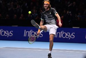 Stefanos Tsitsipas kicks the ball as he celebrates victory against Switzerland's Roger Federer. Picture: AFP/Getty