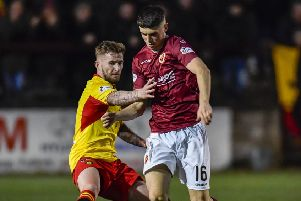 Partick Thistle's Chris Slater, left, battles for the ball with Stenhousemuir's Conor McBride. Photograph: Rob Casey/SNS Group