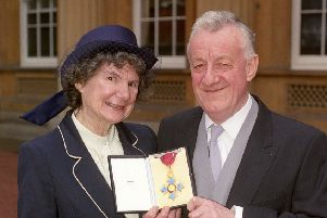 Chris Moncrieff and his wife Maggie displaying his CBE outside Buckingham Palace in 1990.  (Picture: PA Wire)