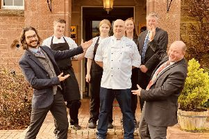 Head chef Iain Gourlay celebrates with staff at Cringletie House.