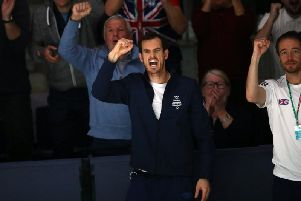 Andy Murray cheers on his British team-mates during the Davis Cup. Picture: Getty