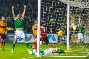 Hibs celebrate after scoring the third goal to seal victory over Motherwell. Picture: SNS
