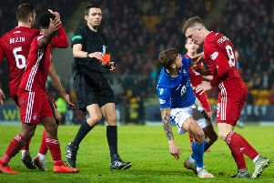Referee Kevin Clancy holds the red card after Callum Hendry fouled Lewis Ferguson (right). Picture: SNS