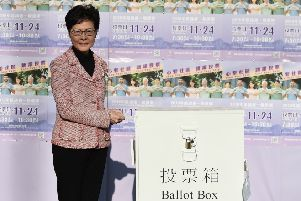 Hong Kong Chief Executive Carrie Lam casts her vote during the district council elections. Picture: Getty