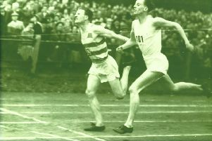 Bobby Quinn, in hooped vest, just beating JV Paterson to the Scottish 440-yard championship