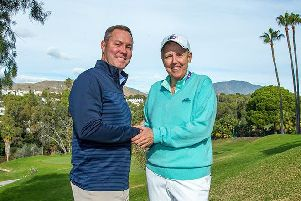 LPGA commissioner Mike What and LET Board chair Marta Figueras-Dotti shake on the merger between the circuits after a meeting in Spain