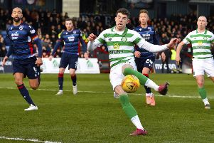 Ryan Christie knocks home the rebound after his missed penalty to give Celtic the lead. Picture: Rob Casey/SNS Group