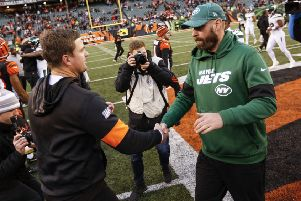 Cincinnati Bengals head coach Zac Taylor, left, and New York Jets head coach Adam Gase, right, shake hands. Picture: Frank Victores/AP