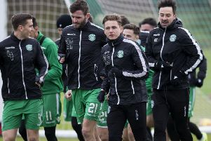 Jason Naismith and Scott Allan lead the Hibs players at training ahead of Wednesday night's game against Ross County. Picture: Bruce White/SNS