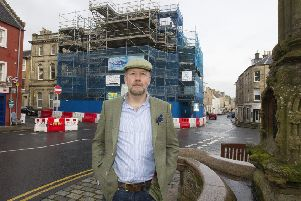 Rob Armstrong outside the scaffolding-clad building in Jedburgh.