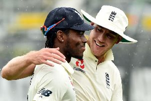 England's pacemen Jofra Archer and Stuart Broad leave the field as rain stops play on the fifth day of the second Test. Picture: Peter Parks/AFP via Getty Images