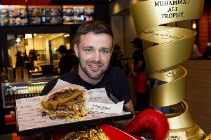 Josh Taylor took his boxing trophies along to the opening of German Doner Kebab on Lothian Road in Edinburgh. Picture: Ross MacDonald / SNS
