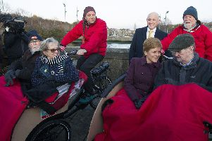 Keith Irving, back left, pedalling a trishaw during Nicola Sturgeon's recent visit to Hawick.