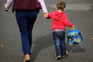 Working parents need to balance the demands of their job with ensuring their children are well looked after (Picture: Brian Lawless/PA)