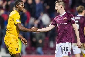 Hearts goalscorer Steven MacLean shakes hands with Livingston's Marvin Bartley who was also on target in the 1-1 draw at Tynecastle. Picture: Roddy Scott/SNS