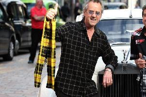 Bay City Rollers star Stuart 'Woody' Wood was the hero after he reunited lost pooch Kruger with his family.