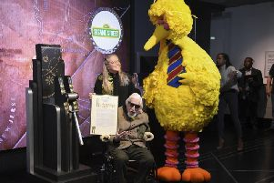 Sesame Street's Big Bird and puppeteer Caroll Spinney  (Photo by Evan Agostini/Invision/AP, File)