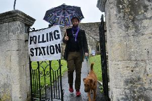 A voter leaves a polling station at a village church (Photo: Shutterstock)