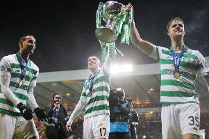 Ryan Christie holds aloft the Betfred trophy with  Kristoffer Ajer.