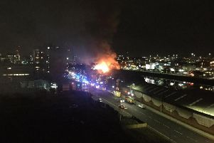 Eyewitnesses reported flames shooting from the roof of the three-storey building near Lancefield Quay. Picture: Giggles Glittermallow