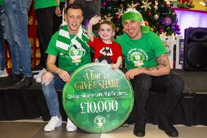 Callum McGregor, left, Celtic captain Scott Brown and four-year-old Mitchell Buchanan from Lenzie at Glasgow Children's Hospital. Picture: Ross MacDonald/SNS