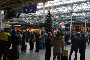 Passengers queue for the information desk at Edinburgh Waverley this afternoon