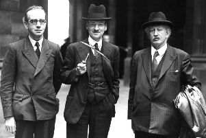 Clement Attlee, centre, with MPs Arthur Jenkins, left, and Neil McLean, in 1941 when the Labour leader was Deputy Prime Minister in a national coalition led by Winston Churchill (Picture: D Reid)