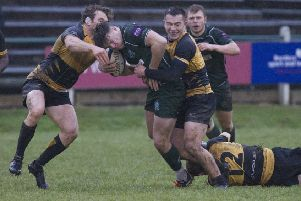 Hawick's Andrew Mitchell receives some individual attention last Saturday from Currie Chieftains (picture by Bill McBurnie)