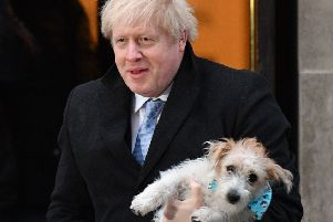 Britain's Prime Minister Boris Johnson poses with his dog Dilyn as he leaves from a polling station. Picture: Daniel Leal-Olivas/AFP via Getty Images