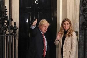 Prime Minister Boris Johnson and his girlfriend Carrie Symonds arrive in Downing Street after the Conservative Party was returned to power