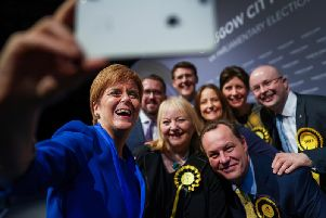 Celebrating too soon? Nicola Sturgeon takes a selfie with newly elected MPs at the general election count in Glasgow (Picture: Jeff J Mitchell/Getty)