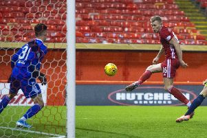 Sam Cosgrove opens the scoring for Aberdeen against Hamilton. Picture: Ross MacDonald / SNS