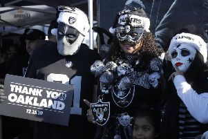 Raiders fans say goodbye to their home stadium. Picture: AP