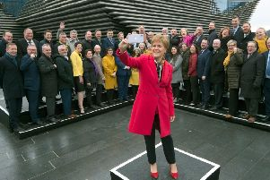 Nicola Sturgeon takes a selfie with the SNP's newly-elected MPs at the V&A in Dundee. (Picture: AFP/Getty)