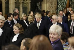Boris Johnson walks through the Commons members lobby for the State Opening of Parliament (Picture: Kirsty Wigglesworth/PA Wire)